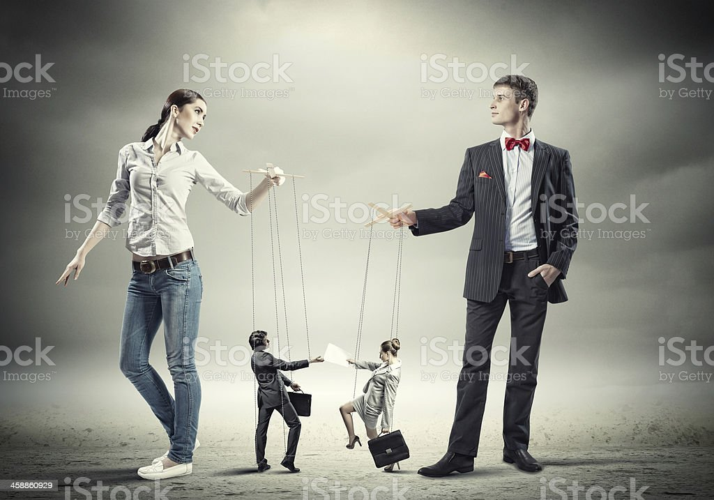 Businesspeople with marionettes stock photo