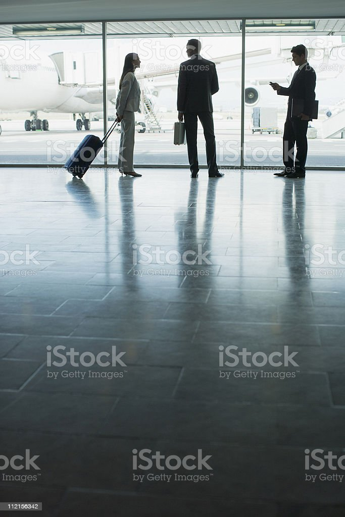 Businesspeople with suitcase in airport royalty-free stock photo