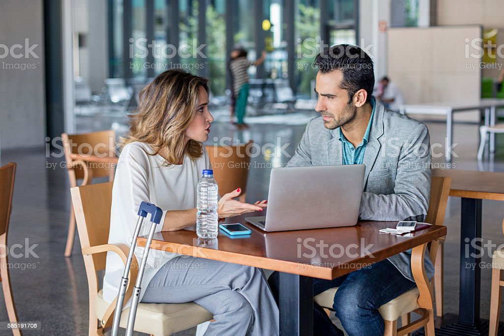 Businesspeople working in an airport cafeteria stock photo
