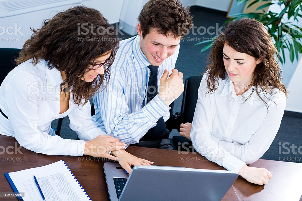 Businesspeople working on computer royalty-free stock photo