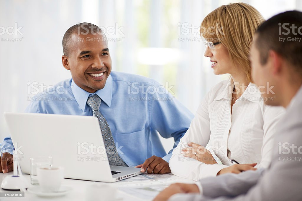 Businesspeople working on laptop in an office. royalty-free stock photo