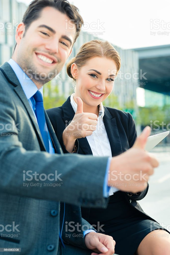 Businesspeople working outdoor stock photo