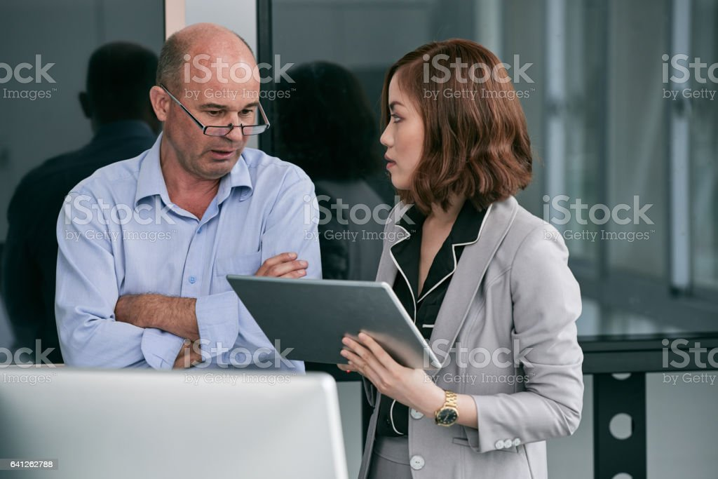 Businesspeople working together in office stock photo