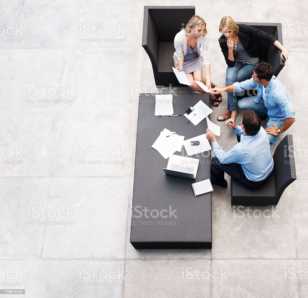 Businesspeople working together on future business plan stock photo