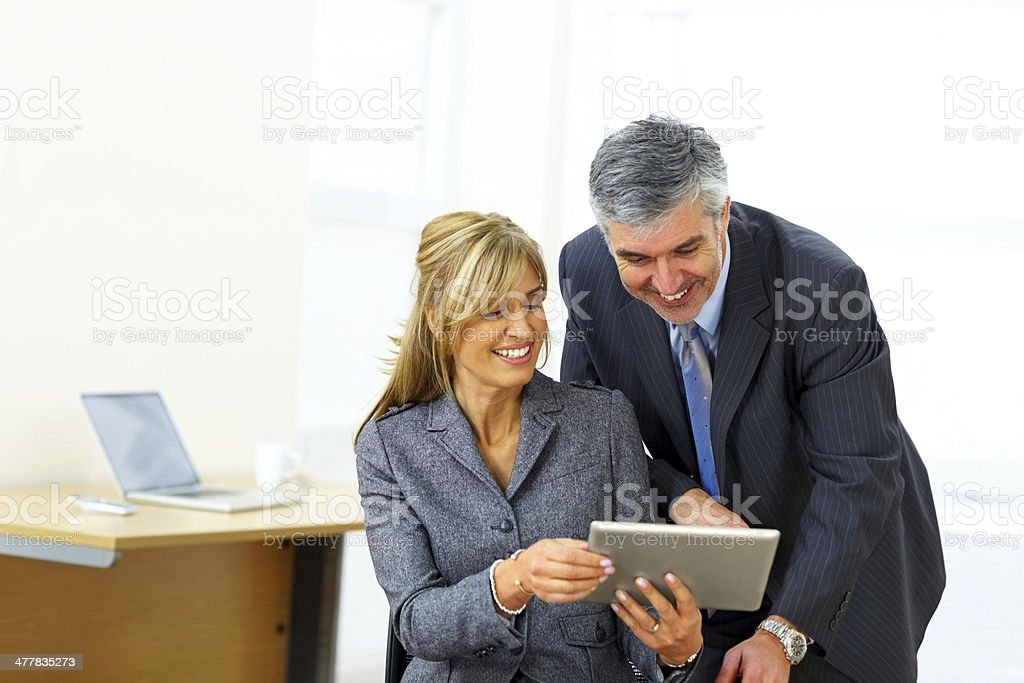 Businesspeople working together with digital tablet in office royalty-free stock photo