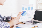 Businessperson analyzing report