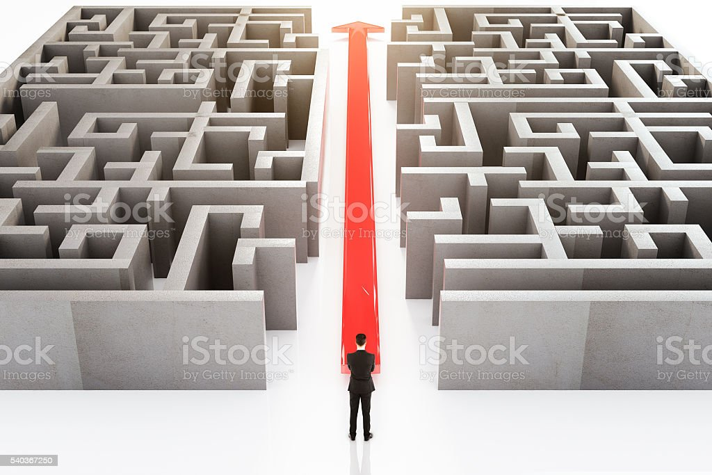 Businessperson and maze stock photo