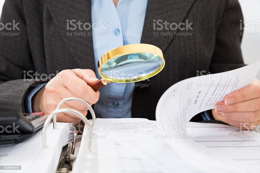 Businessperson Checking Bills stock photo