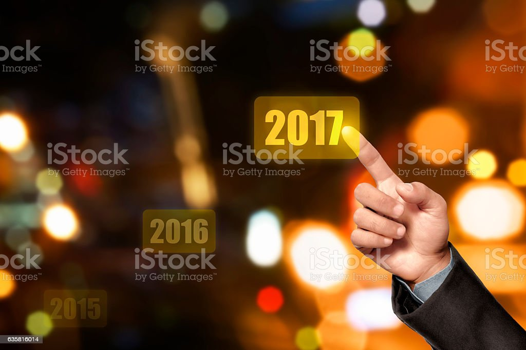 Businessperson hand touching 2017 number stock photo