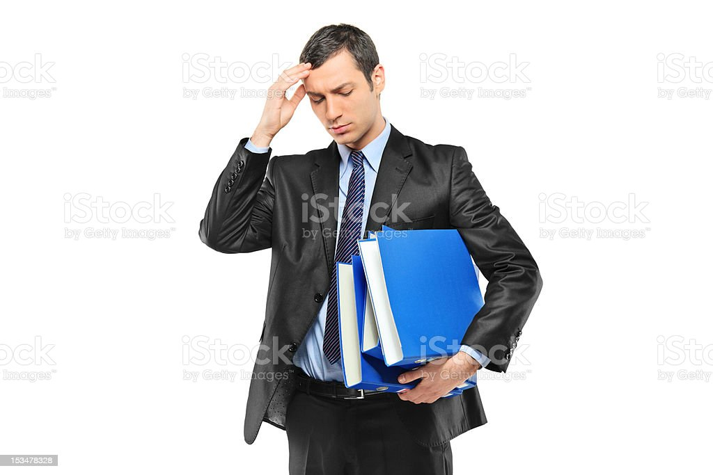 Businessperson holding his head in pain royalty-free stock photo