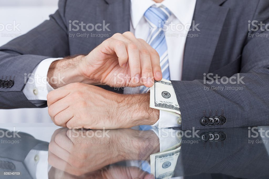 Businessperson Removing Bank Note From Sleeve stock photo