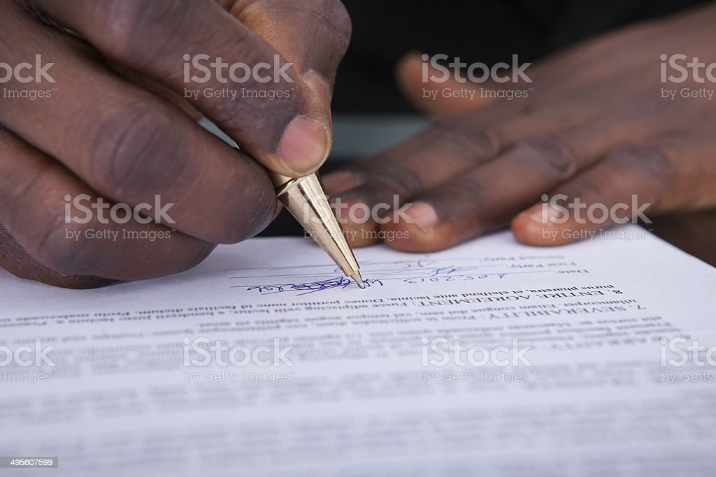 Businessperson Signing Contract stock photo