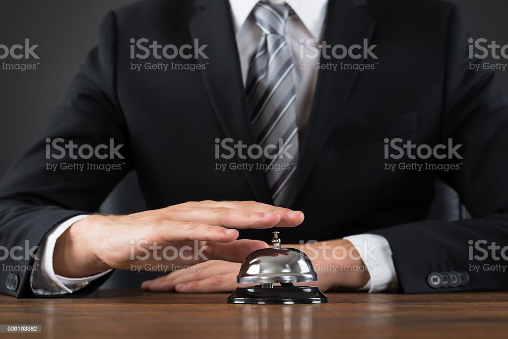 Businessperson Using Service Bell stock photo