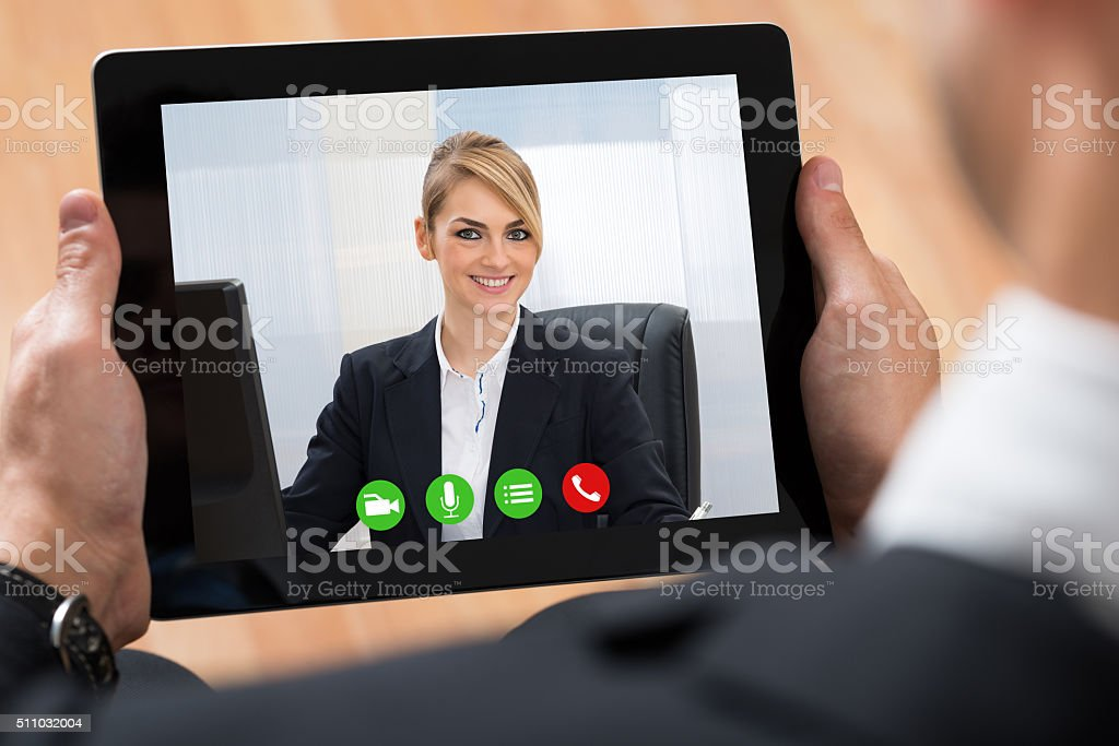Businessperson Videochatting On Digital Tablet stock photo