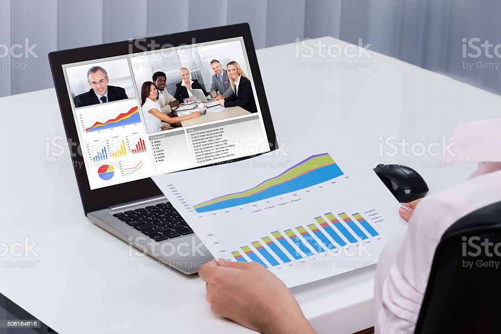 Businessperson Videoconferencing On Laptop stock photo
