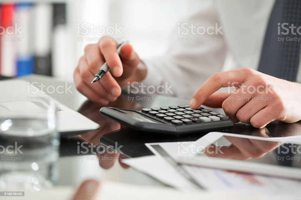 Businessperson working in office stock photo