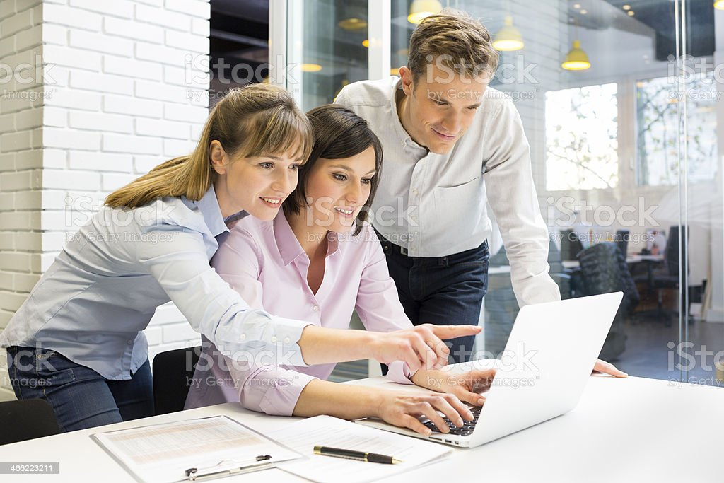 Businessteam presentation on laptop in office royalty-free stock photo