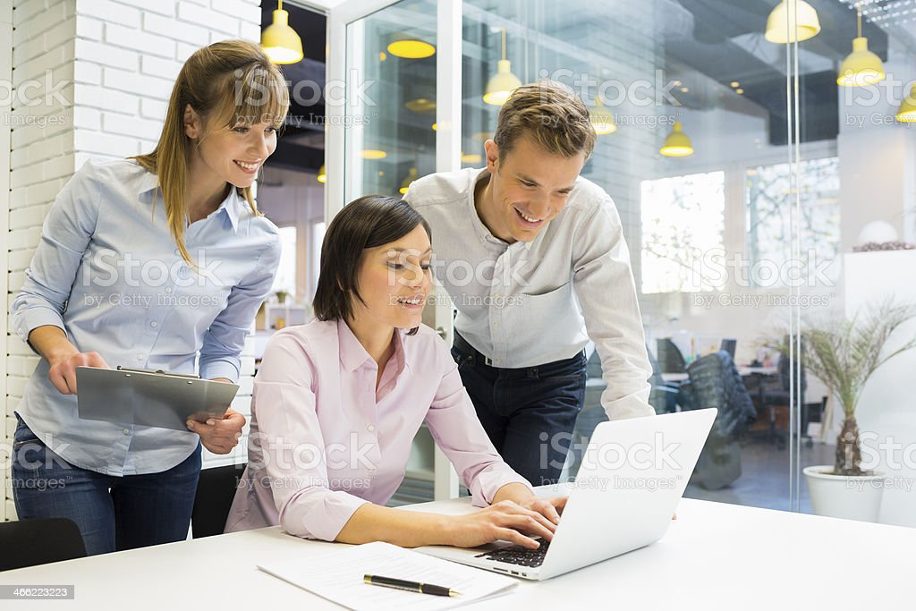 Businessteam presentation on laptop in office stock photo