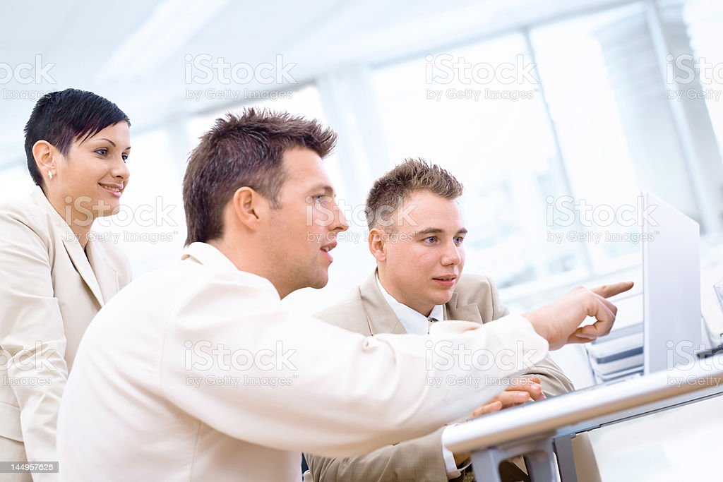 Businessteam with laptop royalty-free stock photo