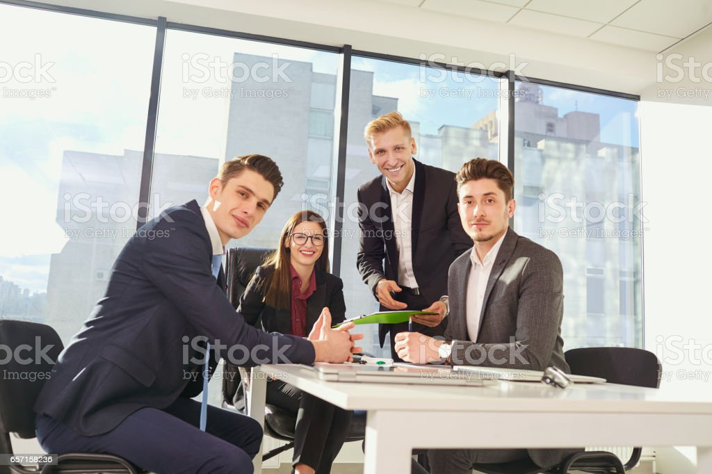Businessteam working at  desk  a modern office. Training busines stock photo