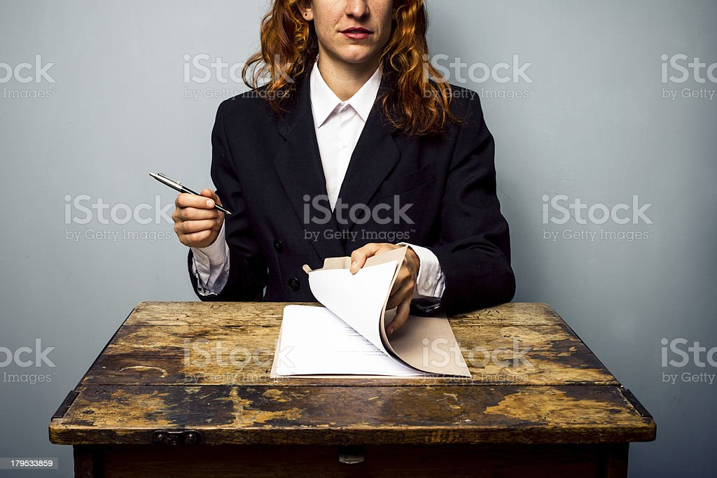 Businesswoman about to sign contract royalty-free stock photo