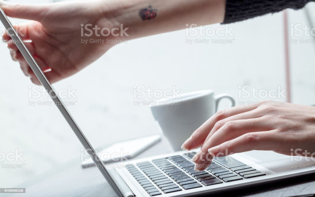 Businesswoman adjusting her screen height stock photo