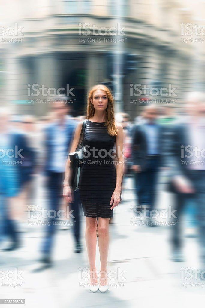 Businesswoman among men stock photo