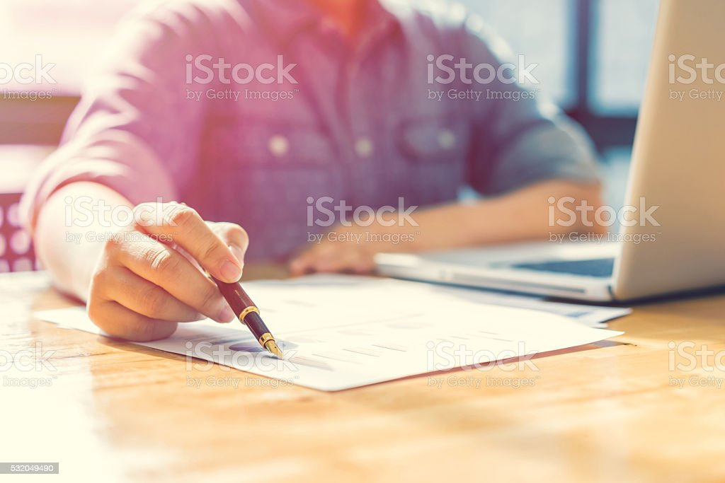 Businesswoman analyzing investment charts. Accounting stock photo