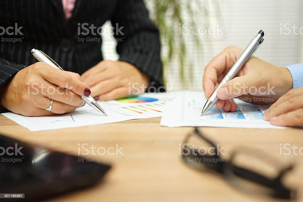 businesswoman and businessman are discussing about financial data on meeting stock photo