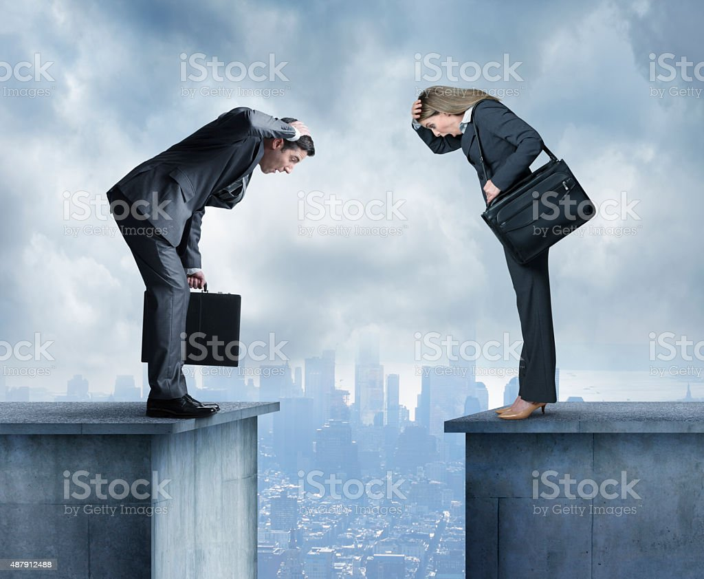 Businesswoman and businessman stare at space between two buildings stock photo