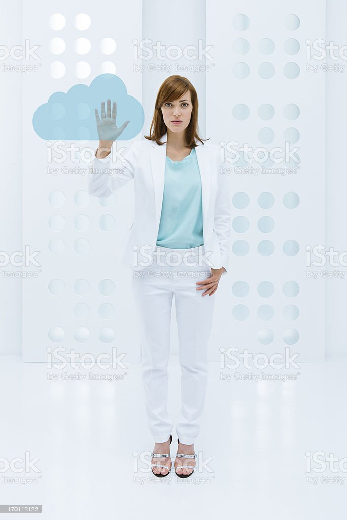 Businesswoman and cloud computing concept stock photo
