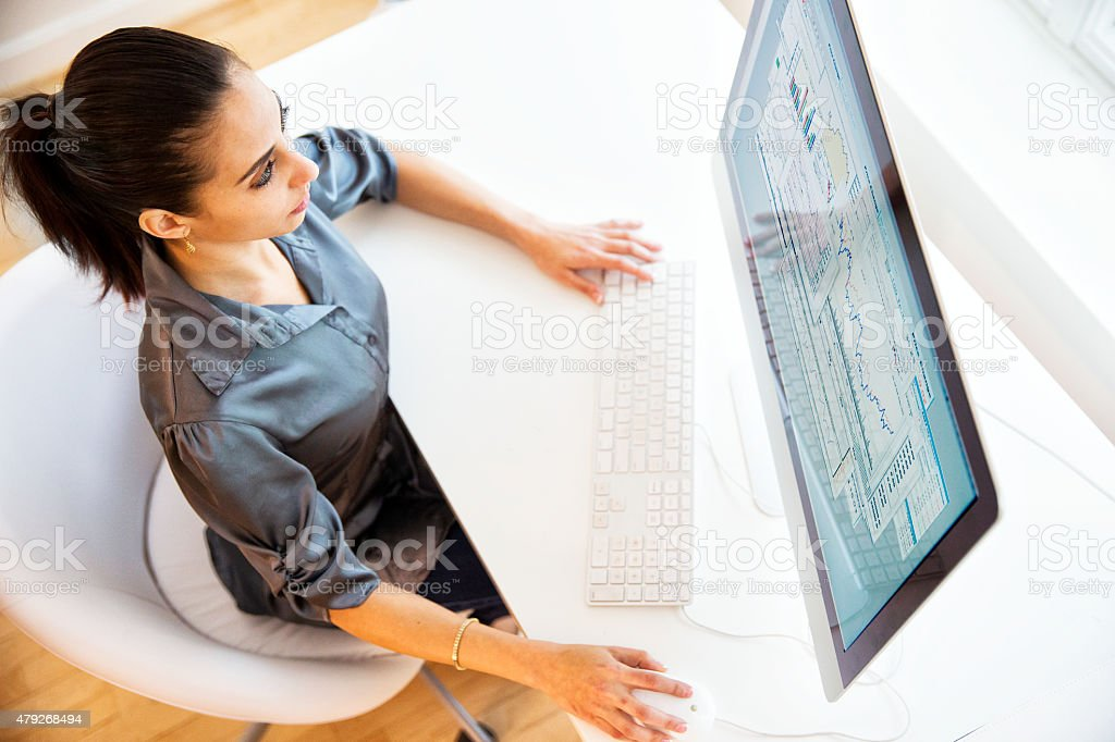 Businesswoman and Computer Monitor stock photo