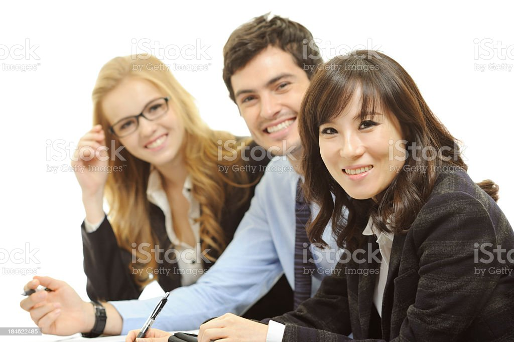 Businesswoman and her associates smiling royalty-free stock photo