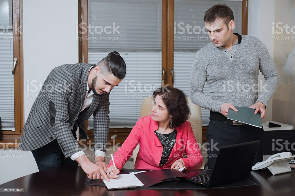 Businesswoman and his assistants secretaries in his office. stock photo