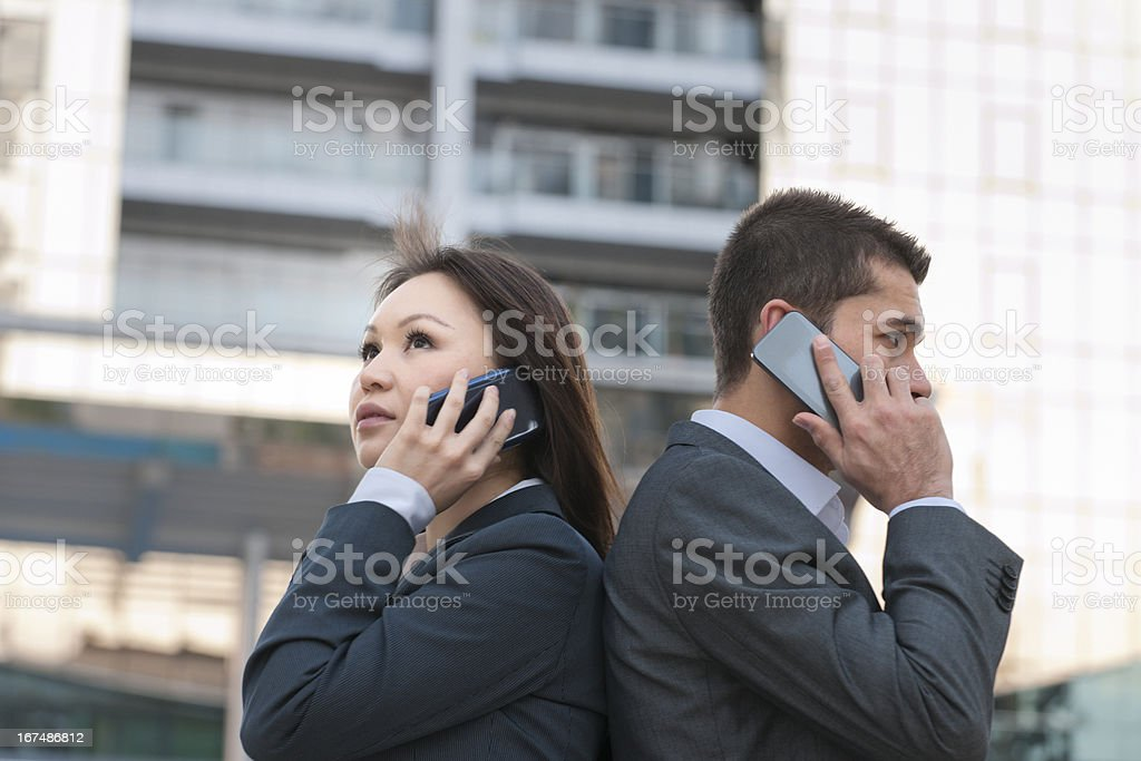businesswoman and man on the phone in Dubai stock photo