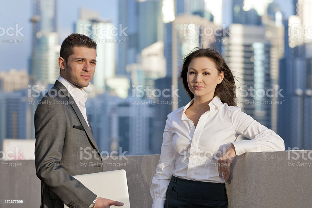 businesswoman and man with laptop in financial district stock photo