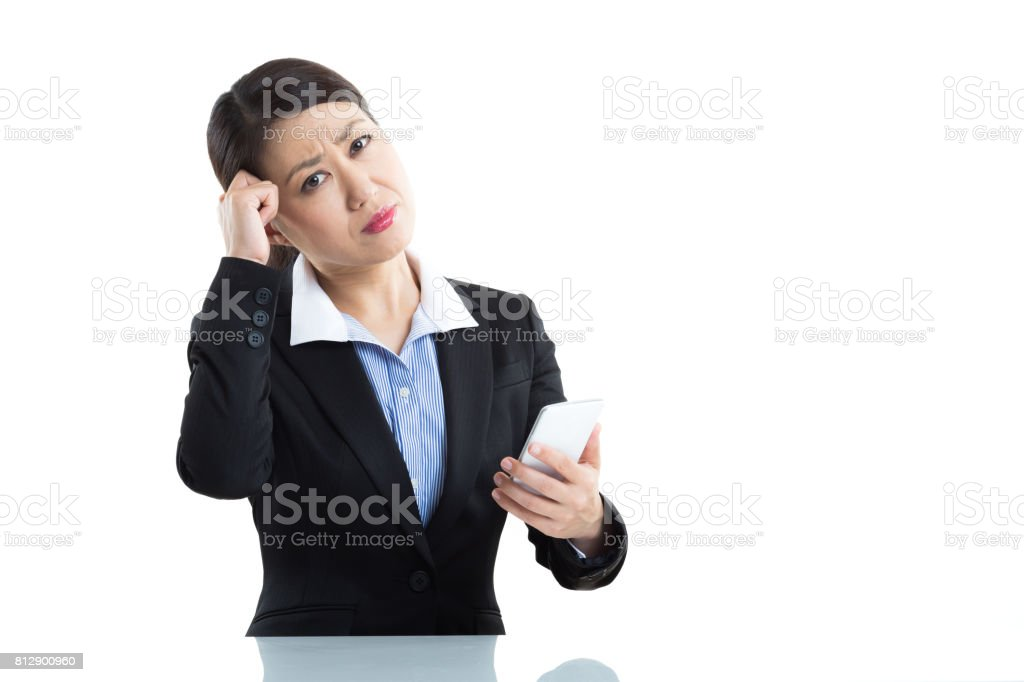 Businesswoman and smart phone stock photo