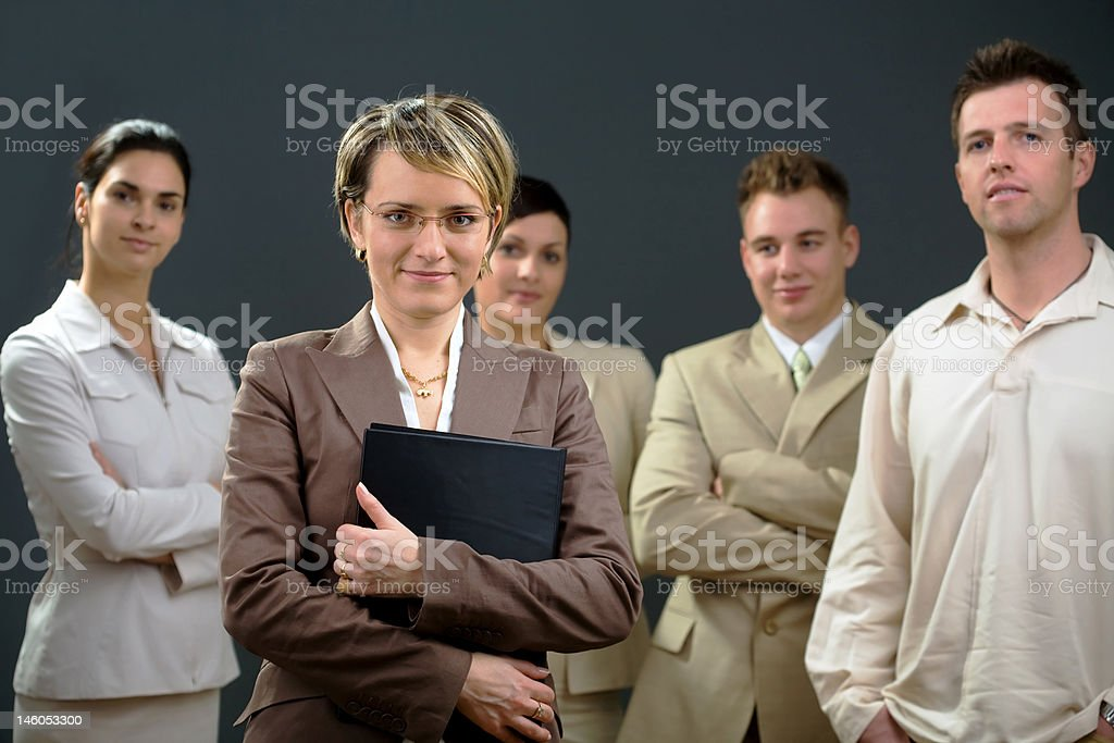 Businesswoman and team royalty-free stock photo