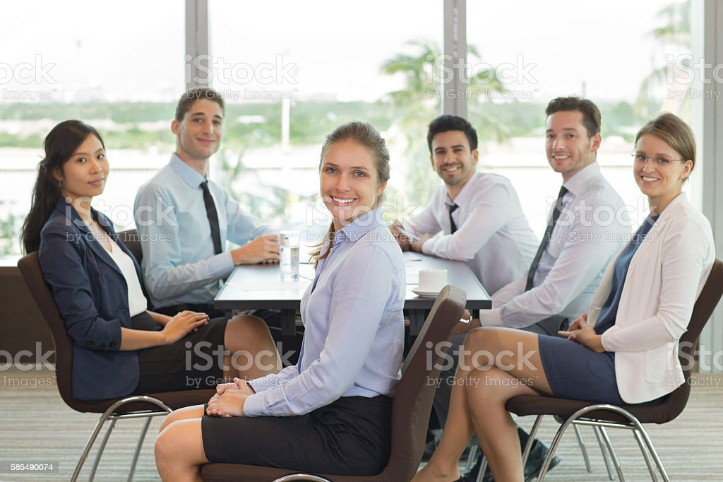 Businesswoman and Team Sitting in Office stock photo