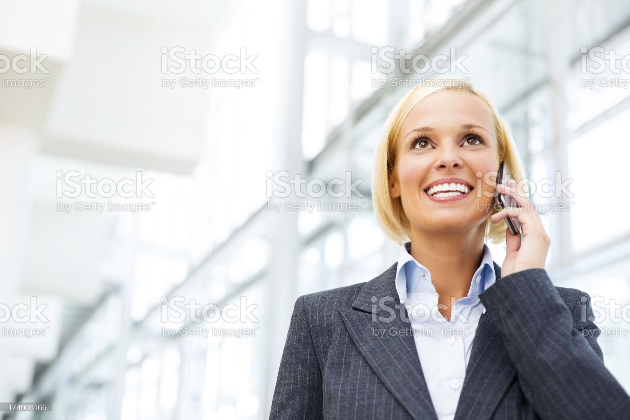 Businesswoman Answering Phone Call royalty-free stock photo
