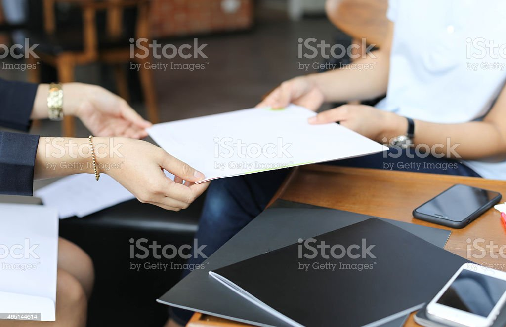 Businesswoman are handing a contract stock photo