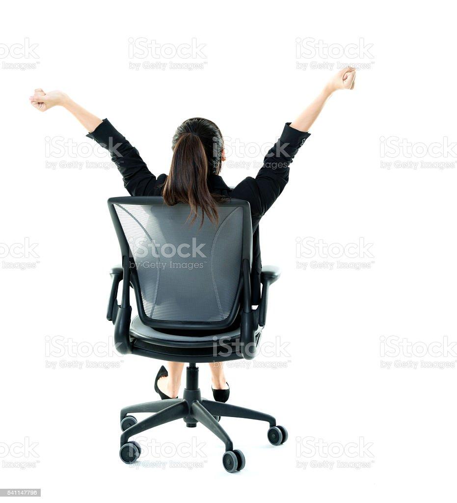 Businesswoman arms raised stock photo