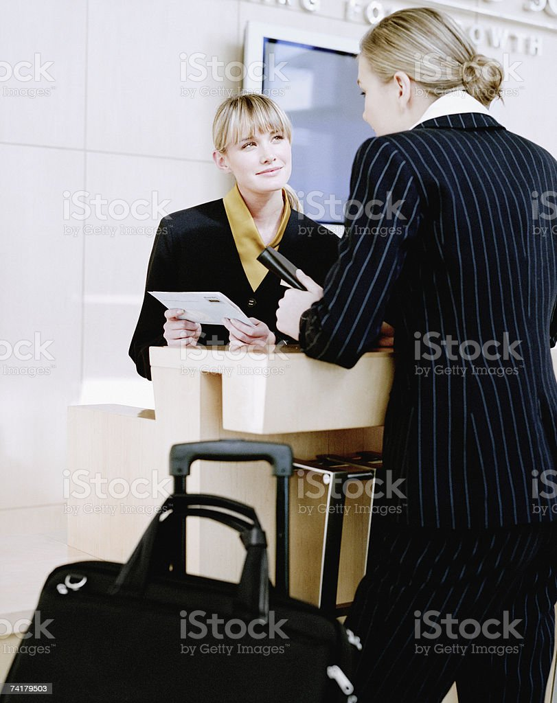 Businesswoman at airport check in counter royalty-free stock photo
