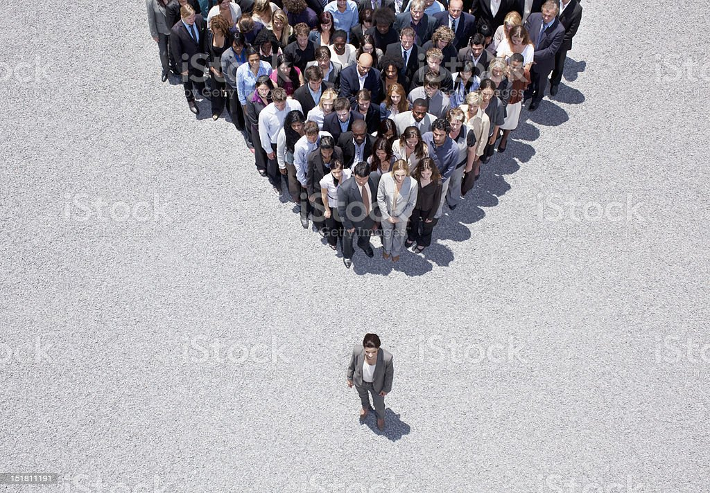 Businesswoman at apex of crowd stock photo