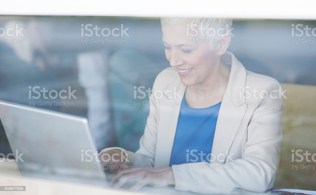 Businesswoman at cafe stock photo