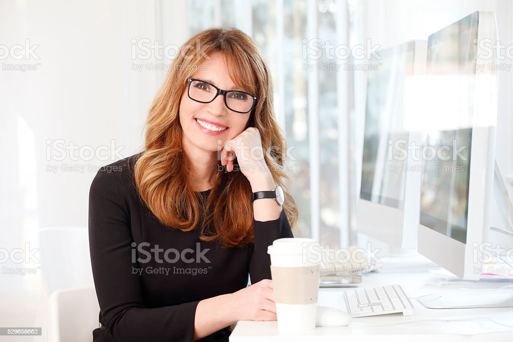 Businesswoman at coffee break stock photo