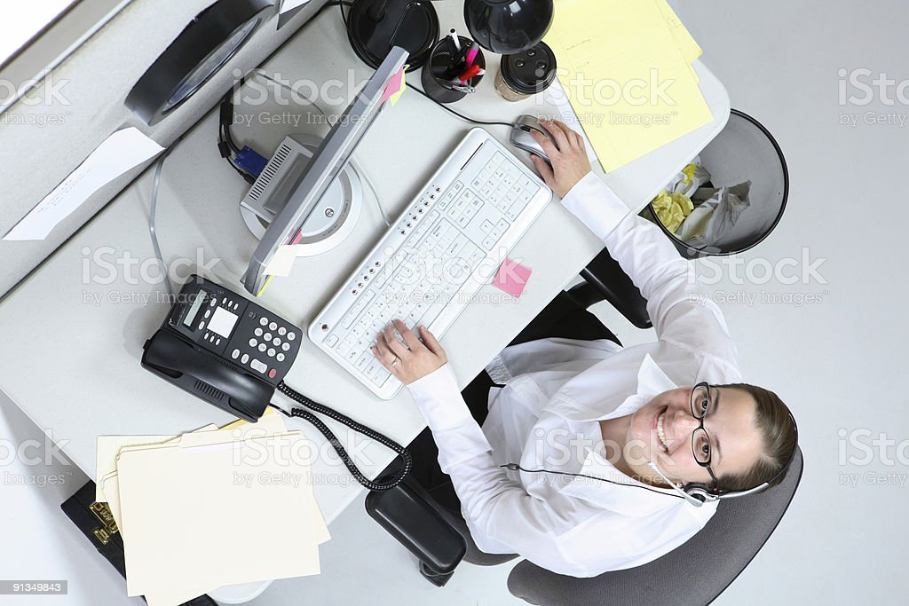 Businesswoman at desk royalty-free stock photo
