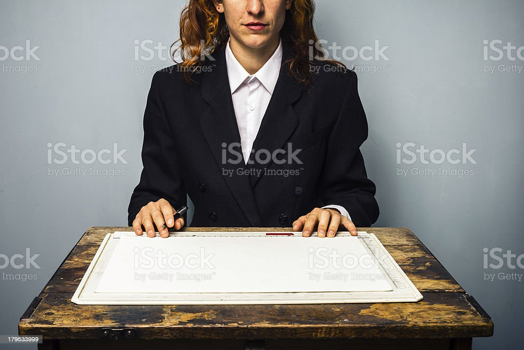 Businesswoman at drawing board royalty-free stock photo