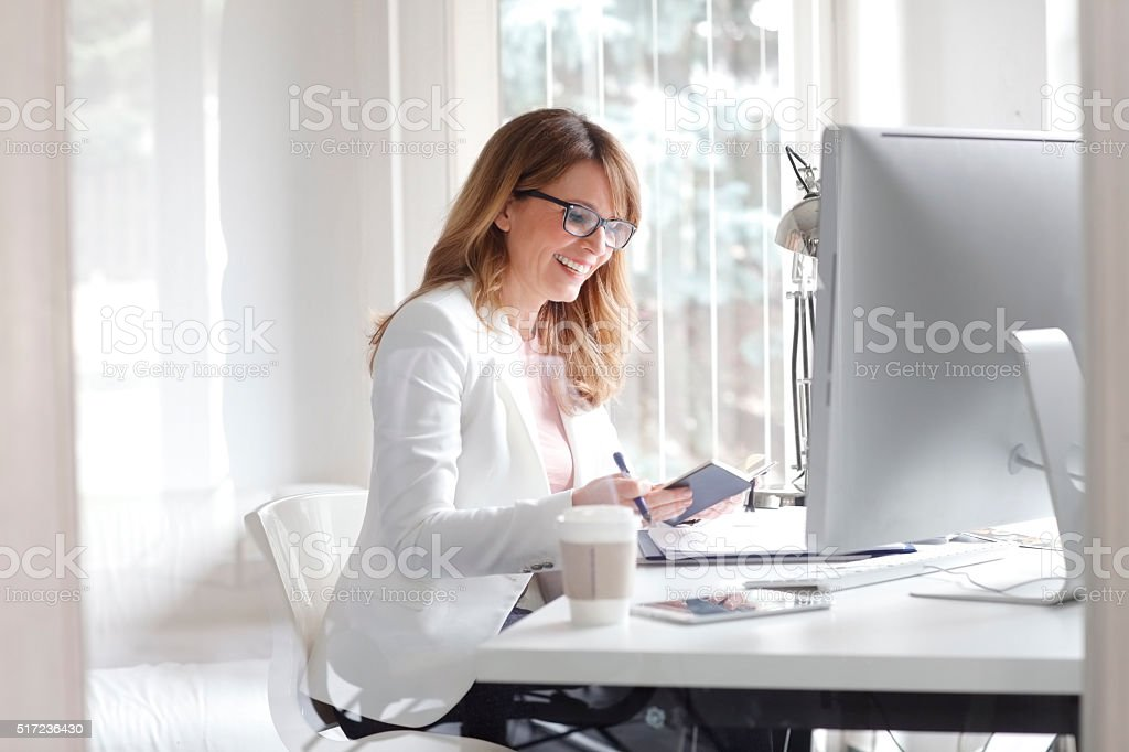 Businesswoman at her workplace stock photo