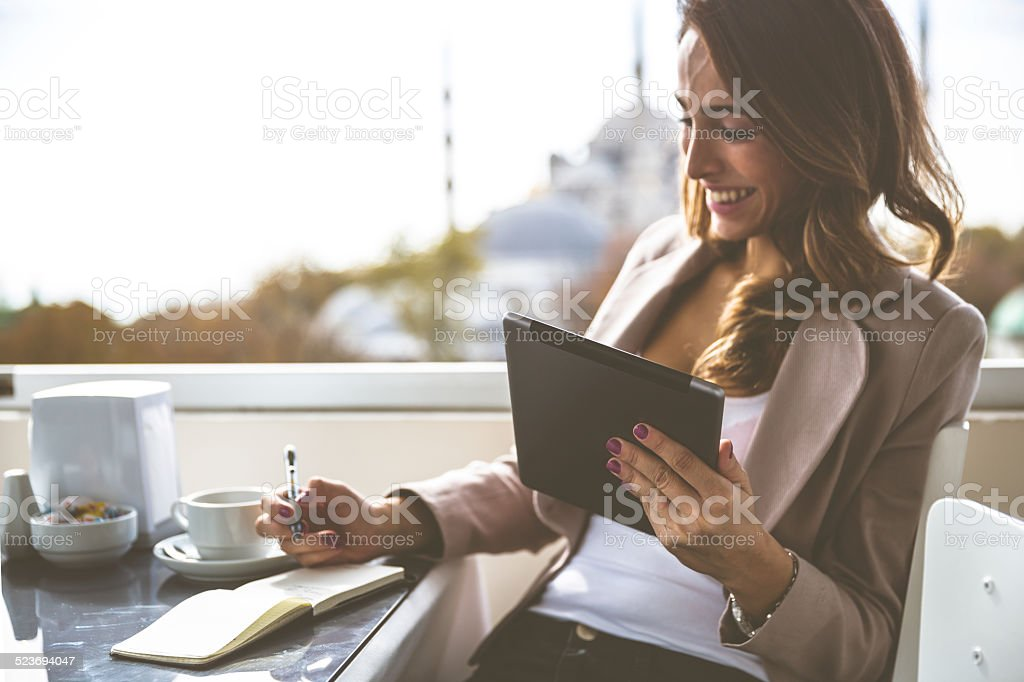 Businesswoman At The Cafè stock photo
